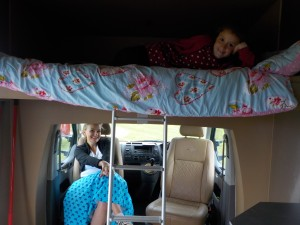 Double bed over cab & swivel seats