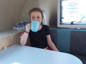 Enjoying a cuppa in the caravan