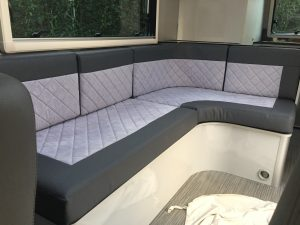 grey curved sofa in motorhome